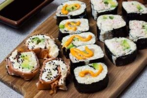 Low Carb Sushi Rolls displayed on wooden board