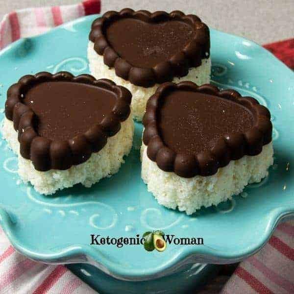 heart shaped keto chocolate coconut bars on blue plate