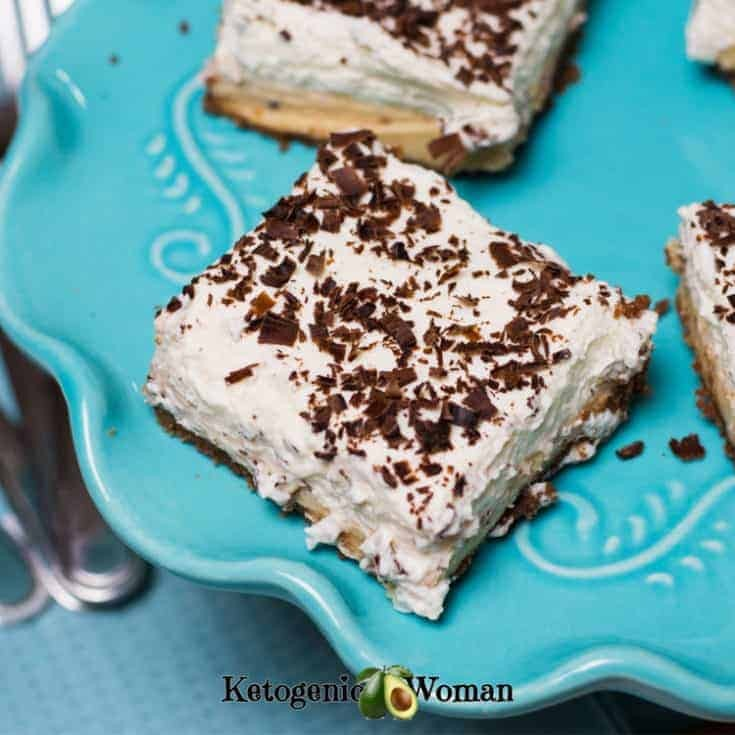 Keto Chocolate Peanut Butter Dessert Bars on a blue plate