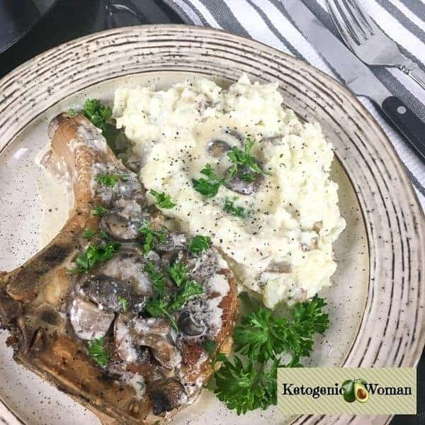 keto pork chop with mushroom gravy on plate