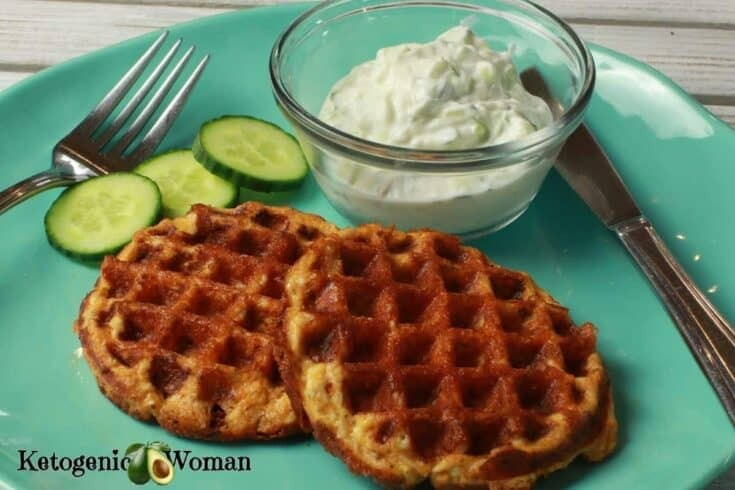 Butter chicken chaffles with sauce and cucumbers on a blue plate