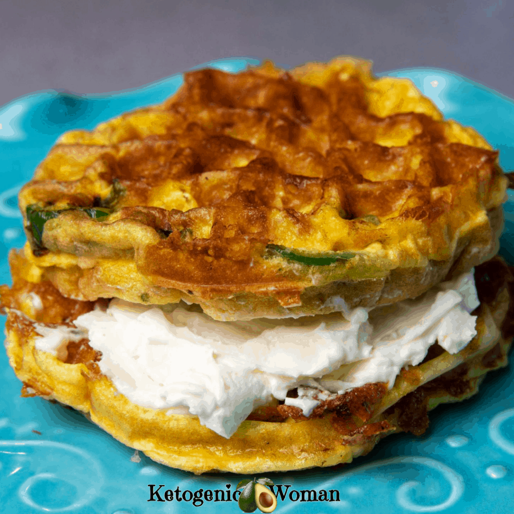 Jalapeno chaffle with cream cheese on blue plate