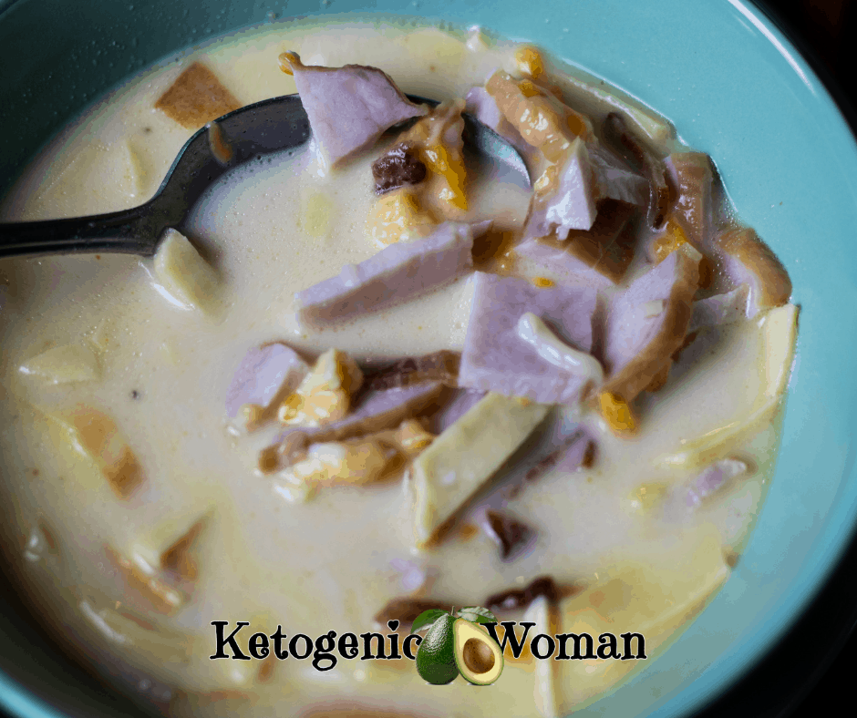 ham and cheese soup in blue bowl with spoon