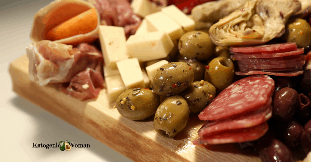meat and cheese laid out on wooden board