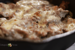 closeup shot of cheesesteak in pan