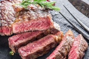Slices of steak on wooden board